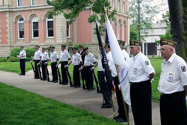 Roger Schneider | The Goshen News<br /> The honor guard lines up on the lawn of the Elkhart County Courthouse Monday morning to pay tribute to the many veterans from Elkhart County who died in the nation's wars. At right is Don Malott, a Vietnam War veteran and to his right is Ed Miller, a Korean War veteran.
