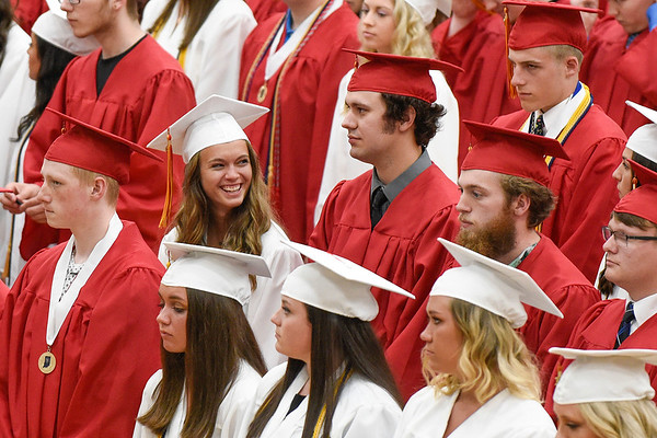 BEN MIKESELL | THE GOSHEN NEWS<br /> Senior Kelby Christner smiles after getting to her seat Thursday evening at Westview Jr. - Sr. High School.