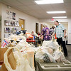 AIMEE AMBROSE | THE GOSHEN NEWS <br /> Carts of food line up at the Salvation Army, 1013 N. Main St., to be weighed and sorted after volunteers collected the donated goods during the annual Stamp Out Hunger food drive Saturday.