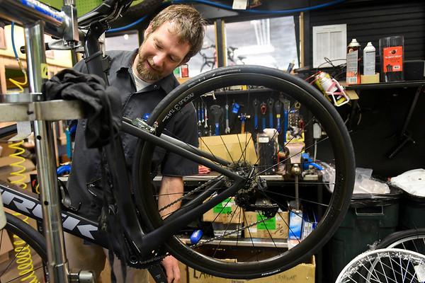 BEN MIKESELL | THE GOSHEN NEWS<br /> Technician Jason Kado works on a Trek Madone bicycle Thursday at Lincoln Avenue Cycling in Goshen.