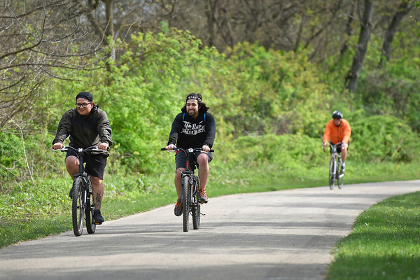 BEN MIKESELL | THE GOSHEN NEWS<br /> George Gaspar, left, rides with George Fuentes, both of Goshen, Wednesday afternoon on the Pumpkinvine Trail near Abshire Park.