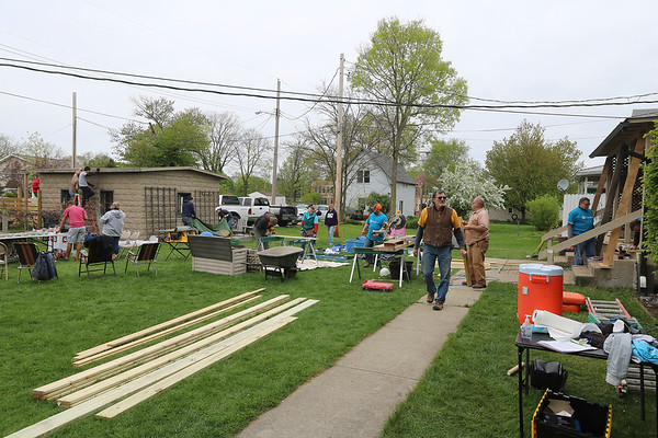 AIMEE AMBROSE | THE GOSHEN NEWS <br /> Volunteers work on repair and improvement projects at Rusin and Kimberly Nyce's home in the 1300 block of South Eighth Street in Goshen as part of LaCasa Inc.'s annual Help a House program Saturday.