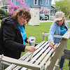 AIMEE AMBROSE | THE GOSHEN NEWS <br /> (from left) Stephanie Smith, Goshen, and Erin Wilson, Goshen, stain a bench while volunteering with a group to do repair and improvement work at Rustin and Kimberly Nyce's house in the 1300 block of South Eighth Street as part of LaCasa Inc.'s annual Help a House program Saturday.