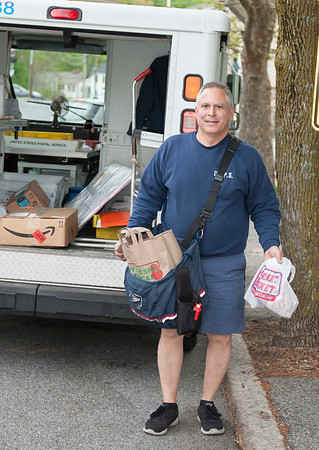 PHOTO CONTRIBUTED<br /> A postal worker picks up food along his route for Stamp Out Hunger in this file photo from 2017 from the U.S. Postal Service.