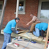 AIMEE AMBROSE | THE GOSHEN NEWS <br /> Volunteers work to build a new porch while helping make repairs and improvements at Rustin and Kimberly Nyce's house in the 1300 block of South Eighth Street in Goshen as part of LaCasa Inc.'s annual Help a House program Saturday.