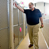 BEN MIKESELL | THE GOSHEN NEWS<br /> Executive director Rob LaRoy walks down the row of kennels Tuesday afternoon at the Humane Society of Elkhart County.