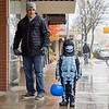 Joseph Weiser | The Goshen News<br /> Harrison Limn, 4, of Goshen walks with his father Patrick Limn during the downtown Goshen trick or treat on Thursday.