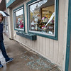 Joseph Weiser | The Goshen News<br /> Goshen Antique Mall vendor Pat Yonkers of Elkhart reacts after a deer shatters the window of the Goshen Antique Mall on Thursday.