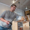 Joseph Weiser | The Goshen News<br /> Ceramic Artist Jacob Hostetler of Goshen setting up his display for first Fridays at the Goshen Historical Museum on Friday.