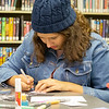 Jezelle Numez, 14, of Goshen makes a greeting card during the Teen Cafe: Make Greeting Cards at the Goshen Public Library Thursday.