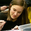 Alena Folty, 16, of Goshen colors a picture for Color a Smile during the Teen Cafe: Make Greeting Cards at the Goshen Public Library Thursday.