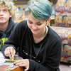 Megan Rumge, 14, of Goshen makes a greeting card during the Teen Cafe: Make Greeting Cards at the Goshen Public Library Thursday.
