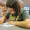 Madieline Hogendodler, 14, of Goshen colors a picture for Color a Smile during the Teen Cafe: Make Greeting Cards at the Goshen Public Library Thursday.