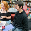 Ash Royer, 15, and Seth Cornelius, 16, of Goshen making greeting cards during the Teen Cafe: Make Greeting Cards at the Goshen Public Library Thursday.