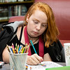 Ash Royer, 15, of Goshen colors a picture for Color a Smile during the Teen Cafe: Make Greeting Cards at the Goshen Public Library Thursday.