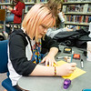 Lisette Crowder, 14, of Goshen makes a greeting card during the Teen Cafe: Make Greeting Cards at the Goshen Public Library Thursday.