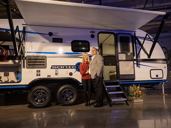 Joseph Weiser   The Goshen News<br /> KZ-RV General Manager Dave Boggs and his wife Shannun Boggs of Warsaw pose for a photo with The Venture Sonic X during the RV Business RV of the year 2020 show at the RV/MH Hall of Fame and Museum in Elkhart Thursday.