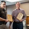 Joseph Weiser | The Goshen News<br /> Elkhart County Sheriff Jeff Siegel awards Bennington Marine Chief Operation Officer Andrew Bona a plaque for covering the cost of the Polaris to a tune of $6,500.