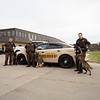 Joseph Weiser | The Goshen News<br /> Elkhart County Sheriff K9 devision pose for a photo after the presentation ceremony at Bennington Marine in Elkhart Monday. Bennington Marine, Godfrey, and Hurricane of Polaris covered the cost of the Polaris to a tune of $6,500.