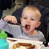 Liam Manduka, 3, Warsaw, takes a big bite of pancake during the Salvation Army's 56th annual Pancake Day Friday.
