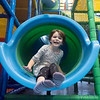 Joseph Weiser | The Goshen News<br /> Adela Crawford, 5, of Wolcottville slides down the slide at The Park at Grace Thursday. The park is located at Grace Community Church 20076 County Road 36<br /> Goshen, In 46526. The Park is open: Monday/Tuesday/Wednesday/Thursday: 9AM - 12PM,Tuesday/Thursday Nights: 5:30PM - 7:30PM, Saturdays: 12PM - 5PM.