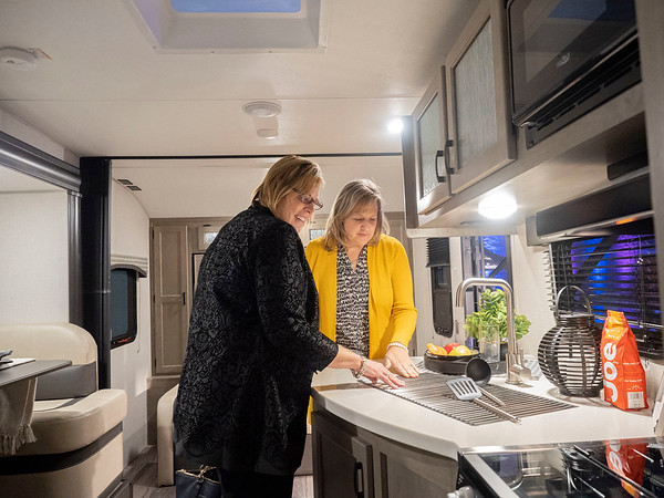 Joseph Weiser   The Goshen News<br /> Kelly Robertson of Ann Arbor and Kinston Phipps of Ann Arbor overlook the galley area of The Venture Sonic X during the RV Business RV of the year 2020 show at the RV/MH Hall of Fame and Museum in Elkhart Thursday.