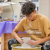 Joseph Weiser | The Goshen News<br /> Andres Mejia, 17, of Elkhart shapes his pot during the 21st annual Concord High School Potters Marathon to benefit Riley Children's Hospital. The goal this year is to make $45,000.00. Since 1999 CHS has raised $413,000.00.