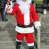 JOHN KLINE | THE GOSHEN NEWS<br /> Santa Claus makes an appearance during the annual Holiday at the Mill celebration at Bonneyville Mill County Park in Bristol Saturday morning.