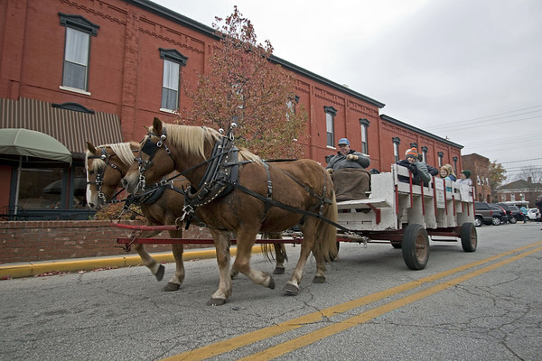 A horse-drawn carriage moves down East Washington Street in downtown Goshen Sunday afternoon during the annual Holiday Open House organized by the Goshen Chamber of Commerce and the Downtown Economic Improvement District.
