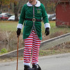 JOHN KLINE | THE GOSHEN NEWS<br /> One of Santa's elves helps direct traffic during the annual Holiday at the Mill celebration at Bonneyville Mill County Park in Bristol Saturday morning.