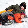 Owen Condict, 9, of Goshen and Vincent Costillo-Miller, 8, of Goshen sledding down the hill at Abshire Park after a record snowfall for Elkhart County of 13 inches fell between Monday night and Tuesday morning. The previous record for Nov.11-12 of 3 1/2 inches was set back in 1959.