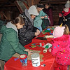 JOHN KLINE | THE GOSHEN NEWS<br /> Attendees try their hand at making holiday ornaments during the annual Holiday at the Mill celebration at Bonneyville Mill County Park in Bristol Saturday morning.