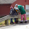 JOHN KLINE | THE GOSHEN NEWS<br /> Visitors to Bonneyville Mill County Park in Bristol Saturday get a surprise visit from one of Santa's helpers as part of Elkhart County Park's annual Holiday at the Mill celebration.