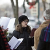 Cosette Torrence, Goshen, and members of Brenneman Memorial Missionary Church sing carols Sunday afternoon outside Fables bookstore in downtown Goshen during the annual Holiday Open House, organized by th Goshen Chamber of Commerce and the Downtown Economic Improvement District.