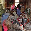 JOHN KLINE | THE GOSHEN NEWS<br /> Attendees wait in line for free snacks, coffee and hot cocoa during the annual Holiday at the Mill celebration at Bonneyville Mill County Park in Bristol Saturday morning.