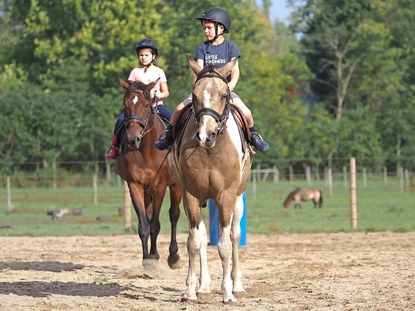 Joseph Weiser | The Goshen News<br /> Greenlee Munoz, 7, and Taavet Munoz, 6, of Goshen participate in horse riding classes at Savage Riding in Goshen Tuesday.