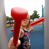 Joseph Weiser | The Goshen News<br /> Calla Hobbs age 5 of Goshen playing on the new playground at Hay Park during the ribbon cutting cerimony on Thursday, October 3, 2019.
