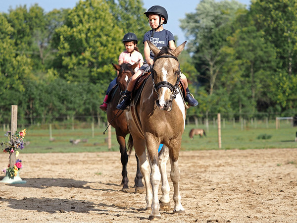 Joseph Weiser   The Goshen News<br /> Greenlee Munoz, 7 and Taavet Munoz, 6, of Goshen participate in horse riding classes at Savage Riding in Goshen Tuesday.