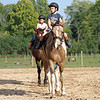 Joseph Weiser | The Goshen News<br /> Greenlee Munoz, 7 and Taavet Munoz, 6, of Goshen participate in horse riding classes at Savage Riding in Goshen Tuesday.