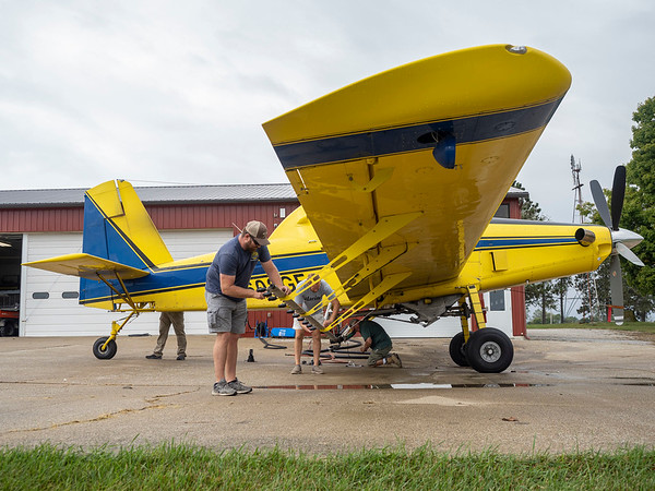 Joseph Weiser   The Goshen News<br /> Pilot of Agriflight prepares the Air Tractor 602  spray attachment for the EEE treatment at Eby Field-1174 on Wednesday, October 02. 2019.