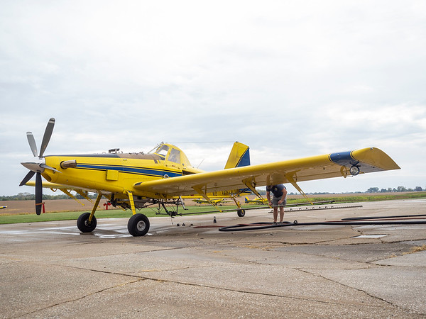 Joseph Weiser | The Goshen News<br /> Pilot of Agriflight prepares the Air Tractor 602  spray attachment for the EEE treatment at Eby Field-1174 on Wednesday, October 02. 2019.