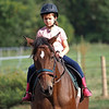Joseph Weiser | The Goshen News<br /> Greenlee Munoz age 7 of Goshen participating in horse riding classes at Savage Riding in Goshen Tuesday.