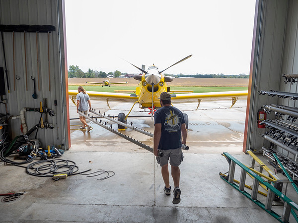 Joseph Weiser | The Goshen News<br /> Pilots of Agriflight prepares spray attachment for the EEE treatment on Wednesday, October 02. 2019.