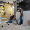Joseph Weiser | The Goshen News<br /> Construction workers Jeff Moles and Jake Chupp performing work on the new restroom area in the Goshen Theater on Thursday, October 3, 2019.