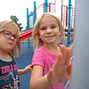 Joseph Weiser | The Goshen News<br /> Calla Hobbs age 5 and Abby Whford age 5 of Goshen playing on the new playground at Hay Park during the ribbon cutting cerimony on Thursday, October 3, 2019.