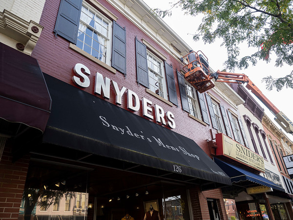 Joseph Weiser | The Goshen News<br /> Snyder's Mens Shop located in downtown Goshen, Indiana undergoes a new face lift by Jorge Tafoya and Roger Garcia of South Bend, Indiana on Monday, September 30, 2019. Face lift will include painting of shutters and a new front entrance.