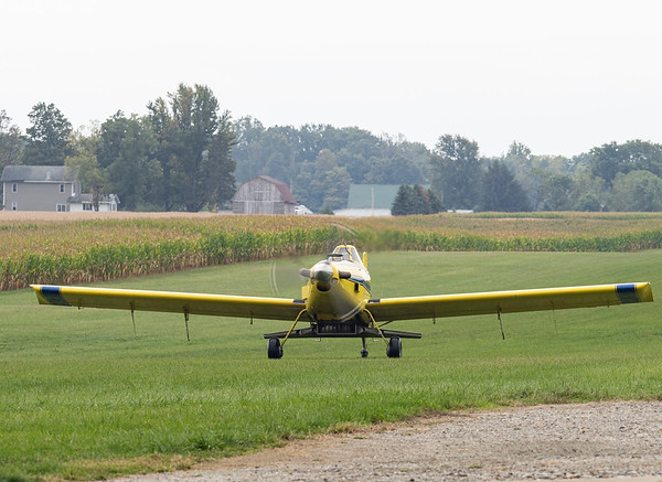 Joseph Weiser | The Goshen News<br /> Pilot of Agriflight in Wakarusa lands at Eby Field-1174 in an Air Tractor 502 with fertilizer attachment on Wednesday, October 02. 2019.