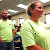 AIMEE AMBROSE | THE GOSHEN NEWS <br /> Ashley Finney, Warsaw, waits for her turn to speak about plans to expand the Osceola Dragway during the Elkhart County Commissioners meeting Monday. Jason Ditto, Elkhart, stands behind Finney.  The two wore green shirts to signal their support of the plans.