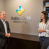 Joseph Weiser | The Goshen News<br /> Goshen Health Foundation Vice President Jim Caskey and assistant campaign director Lindsey Mason speak about the direction of the Goshen Health Foundation during the open house Tuesday morning.