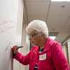 Joseph Weiser | The Goshen News<br /> Retired nurse from Goshen Hospital after serving for 40 years  Dona Cripe of Goshen writes a memory on the wall of the original hospital on Monday.